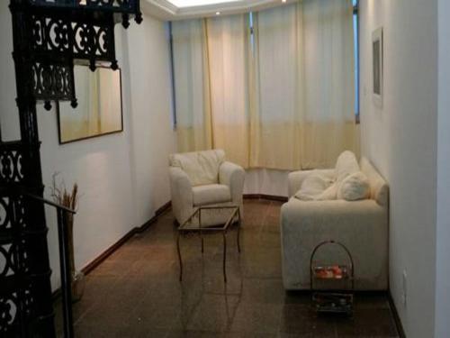 A seating area at Apartamento Vista Mar no Jd.Armação