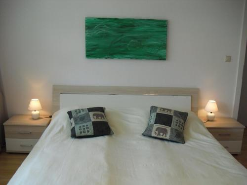A bed or beds in a room at Serviced Apartment with Sunny Balcony