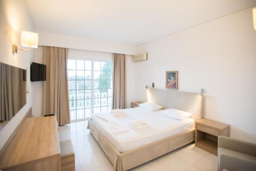 Ένα ή περισσότερα κρεβάτια σε δωμάτιο στο Johannes Apartments