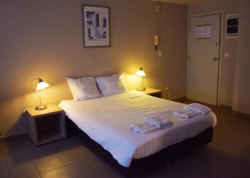 En eller flere senge i et værelse på City Apartments Antwerpen