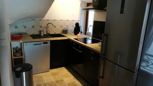 Cuisine ou kitchenette dans l'établissement La petite maison