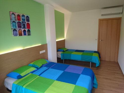 A bed or beds in a room at Cinque Terre Apartments