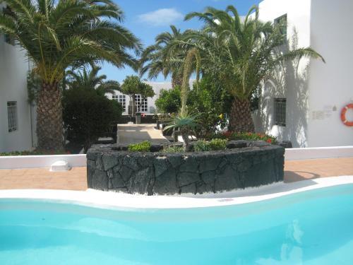 Het zwembad bij of vlak bij Atlantis Las Lomas