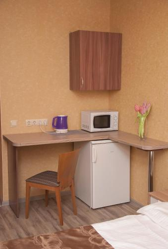 A kitchen or kitchenette at Leningradskoye Vremya