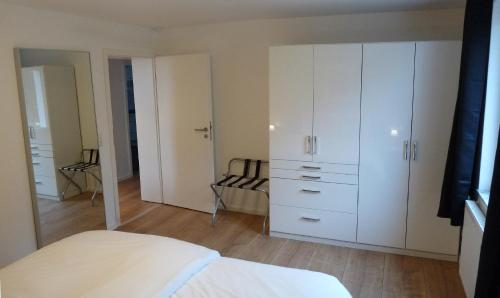 A bed or beds in a room at Bonum Bono Suites