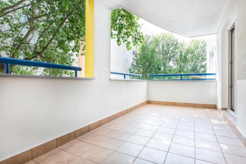 A balcony or terrace at Warm Street Apartment - Peace and Comfort