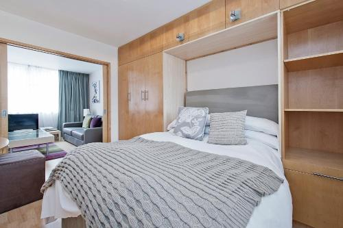 A bed or beds in a room at St Christopher's Place apartments
