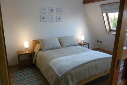 A bed or beds in a room at Edificio Guadalauquen