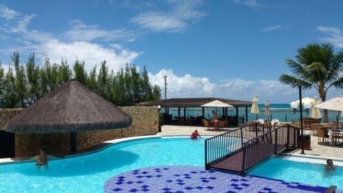 The swimming pool at or near Muro Alto Marupiara Flats