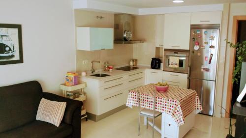 A kitchen or kitchenette at Apartamento Río Vello