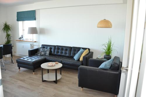 Coin salon dans l'établissement Beach Apartment Ikusasa