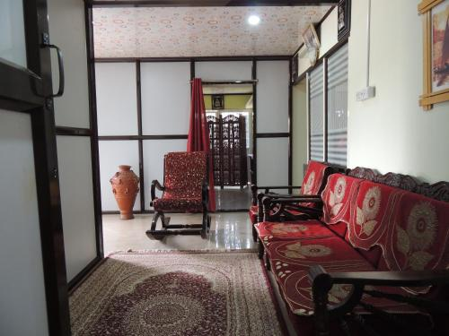 A seating area at Dandeli Home stay