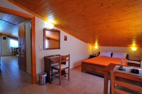 A bed or beds in a room at Sikoudis Gorgona Beach