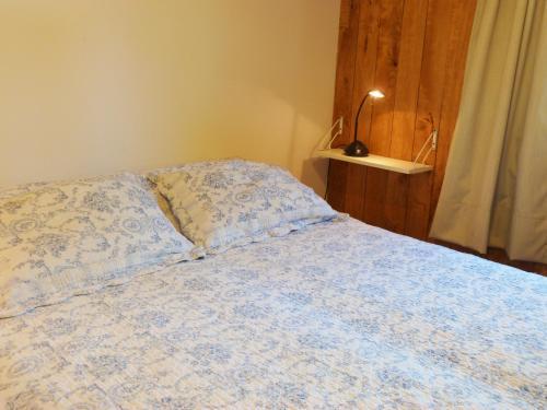 Una cama o camas en una habitación de Departamento Coronel Diaz