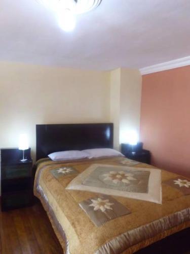 Cama o camas de una habitación en Piuray Hostal Cusco