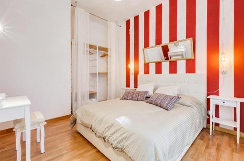 Cama ou camas em um quarto em San Cosimato House