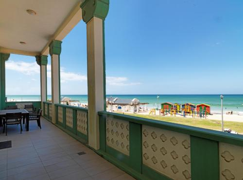 A balcony or terrace at Surferscorner Self Catering Apartments