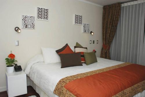 Cama o camas de una habitación en Puerta Arauco Apartamentos