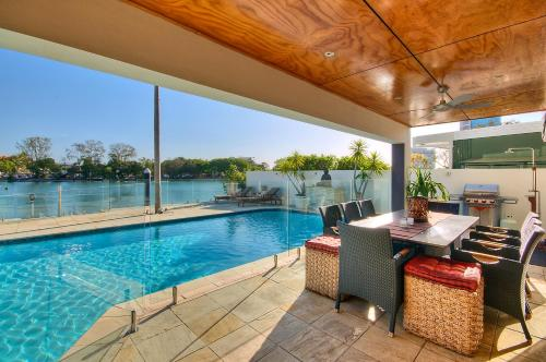 The swimming pool at or near Surfers Paradise Escape - Waterfront House