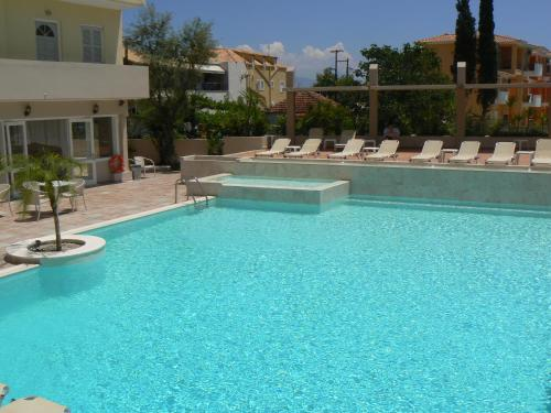 The swimming pool at or near Happyland Hotel Apartments
