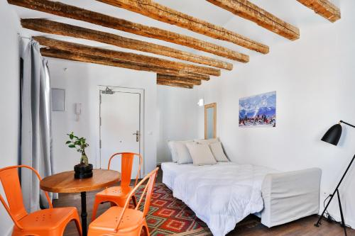 Ein Bett oder Betten in einem Zimmer der Unterkunft Urban Vida Calatrava