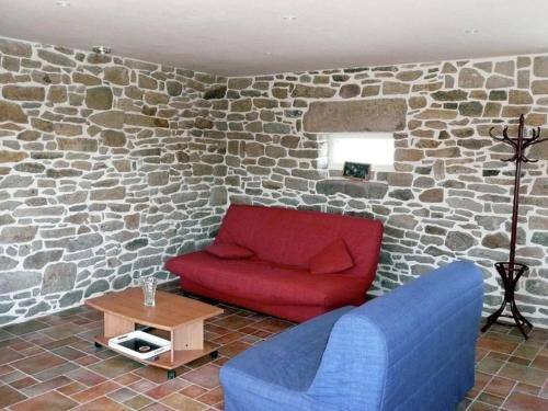 A seating area at Warm Holiday Home at Plozevet Brittany with Lawn