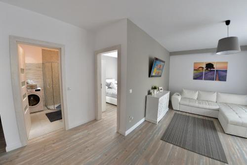 Uma área de estar em Apartament Dodo