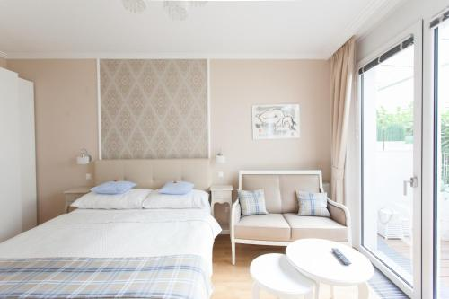 A bed or beds in a room at Sofie Apartments