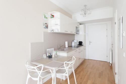 A kitchen or kitchenette at Sofie Apartments