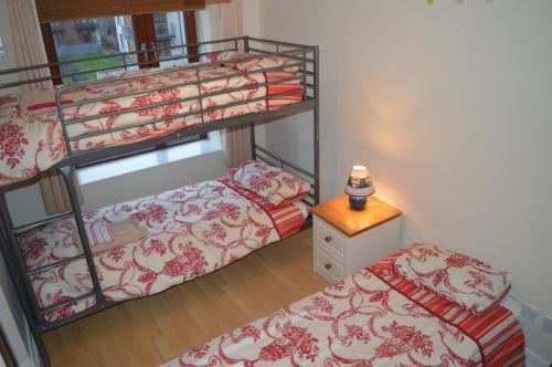A bunk bed or bunk beds in a room at Perfect Airport Apartments