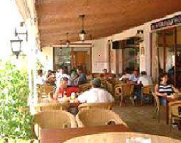 A restaurant or other place to eat at Hostal La Perla