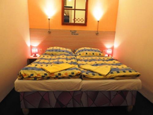 Cama ou camas em um quarto em ACE Apartment