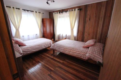 A bed or beds in a room at Chile Wild - Las Vertientes