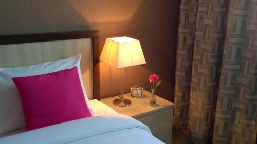 Кровать или кровати в номере Caravan apartments
