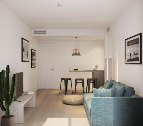 Coin salon dans l'établissement White Apartments - Adults Only