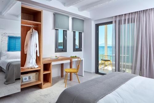 A bed or beds in a room at Icon Suites