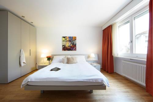 A bed or beds in a room at City Stay Furnished Apartments - Nordstrasse