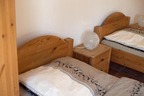 Ein Bett oder Betten in einem Zimmer der Unterkunft Landhof Potsdam Ferienzimmer