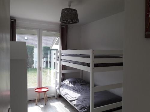 Un ou plusieurs lits superposés dans un hébergement de l'établissement Agon Coutainville