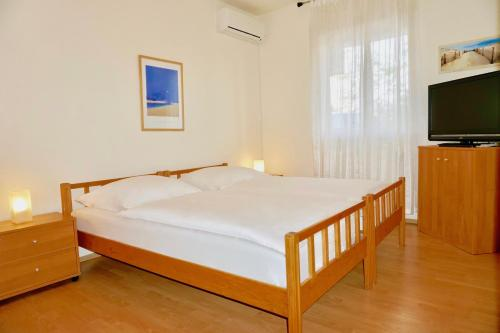 A bed or beds in a room at House Agradable