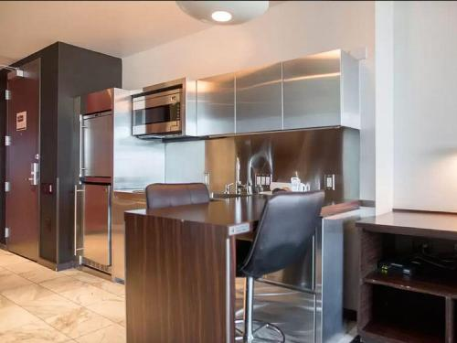 A kitchen or kitchenette at Palms Place 50th floor with balcony & strip view