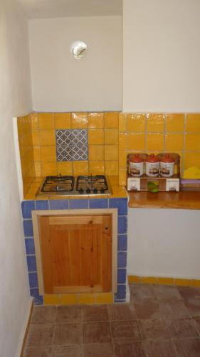 Cucina o angolo cottura di La Casa del Pescatore
