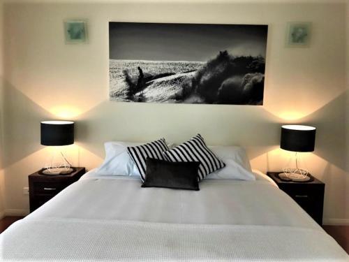 A bed or beds in a room at Compass Point 8