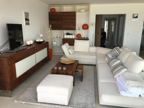 A seating area at De Haan - Apartment Silverbeach