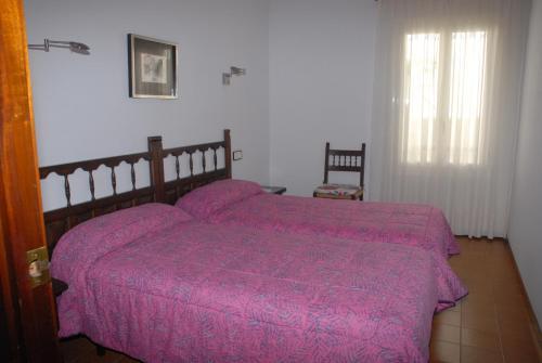 A bed or beds in a room at Apartaments Bonaventura 7