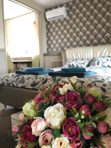 Кровать или кровати в номере Apartment Venetsiya - Paris