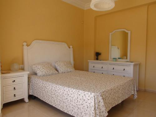 A bed or beds in a room at Playa Puerto Sagunto