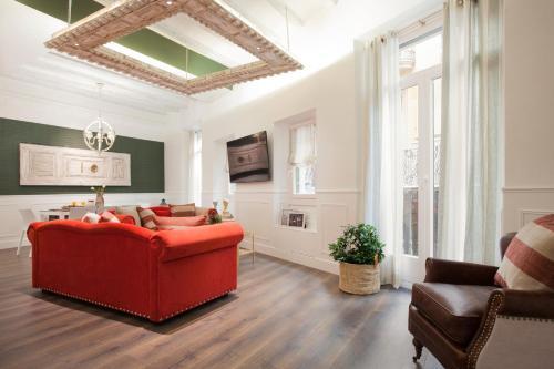 O zonă de relaxare la Enjoybcn Tallers Apartment