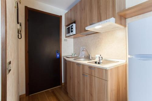 A kitchen or kitchenette at Residence Desenzano