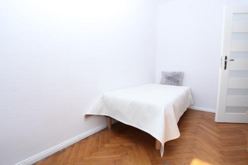 Lova arba lovos apgyvendinimo įstaigoje Krakow Townhouse